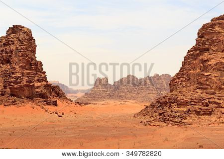 Wadi Rum Desert Panorama With Dunes, Mountains And Sand That Looks Like Planet Mars Surface, Jordan