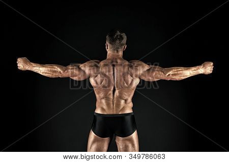 Fit And Athletic. Sportsman Or Bodybuilder. Strong Sportsman Back View Black Background. Sportsman O