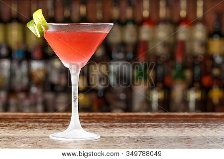 A Traditional Cosmopolitan Cocktail Is On The Bar In The Restaurant. On A Blurry Background Alcohol
