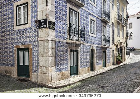 7 March 2018: Lisbon, Portugal - Traditional Ceramic Tiled House With Wrought Iron Balconies On The