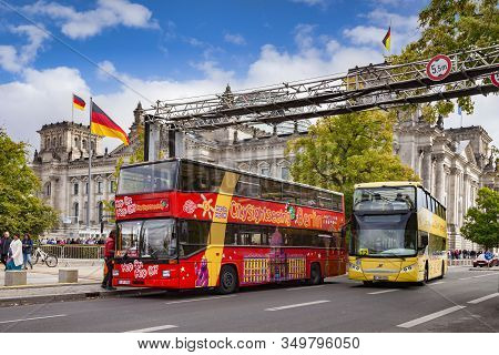 22 September 2018: Berlin, Germany - Tourist Double Decker Buses Near The Reichstag, The German Parl