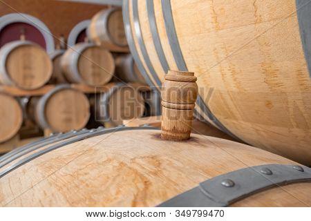 Cork of a wooden wine barrel in wine cellar close up