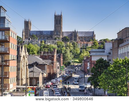 2 July 2019:lincoln, Uk - A View Of The Cathedral, Along Broadgate, A Busy City Centre Street Full O