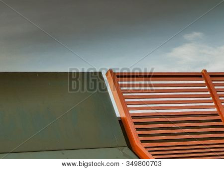 Wooden Sun Lounger At The Beach Or On A Cruise Ship Against Sunny Blue Sky