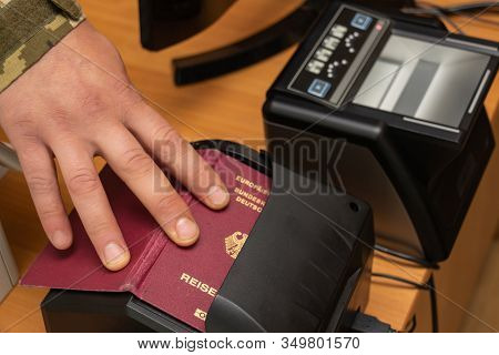 Devices For Scanning Passport Documents, Fingerprinting During Border Control Of Travelers. Automati