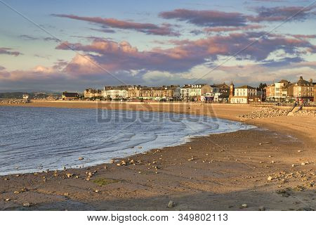 13 July 2019: Morecambe, Lancashire, Uk - The Beach At Sunset, With A Rising Tide.