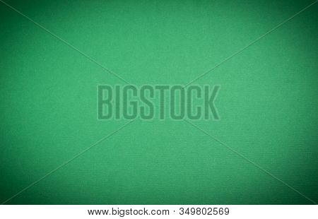 Green Textured Rough Blank Background. Paper Or Fabric. With Venting. Light Oval Inside And Dark Cor