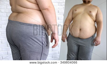 Sad Overweight Man Looking At Fat Belly Mirror Reflection, Weight Loss Problem