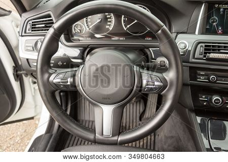 Close-up Of The Steering Wheel Of A Modern Car, Interior, Dashboard, Car Navigation, Automatic Trans