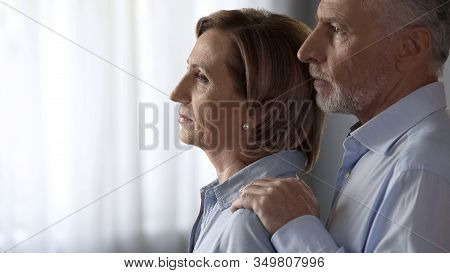Thoughtful Lady Standing By Window, Male Taking Her By Shoulders, Hard Times