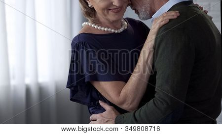 Retiree Male And Female Dancing And Hugging, Lady Smiling Playfully, Happy Time