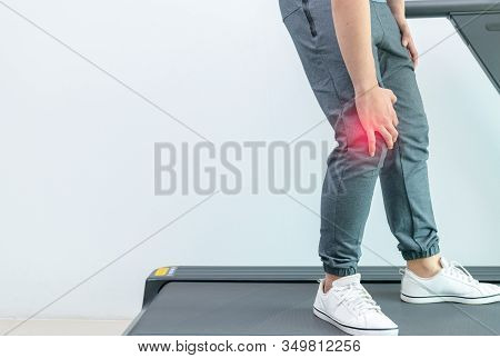 Knee Pain, Close Up Young Man Suffer Knee Pain During Run On Treadmill, Sport Exercising Injury