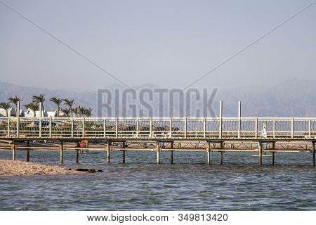 Pier On A Calm Sea On The Background Of The Sinai Mountains, One Of The Coral Reefs In The Red Sea,