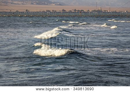Blue Sea Waves On One Of The Coral Reefs Of The Red Sea Off The Coast Of Sharm El Sheikh, The Pier A