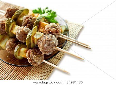 Roast meatballs on skewers