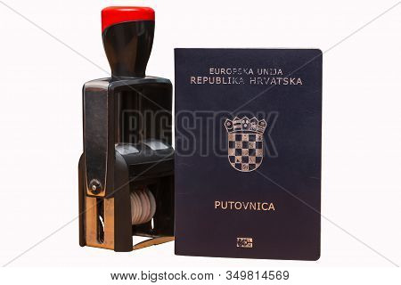 Croatian Biometric Passport And Border Date Stamper Isolated On White Background. Inscription - Euro