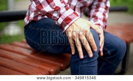 Man Massaging Painful Knee, Suffering From Pain, Injury After Workout, Trauma