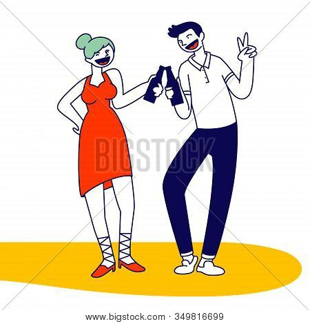 Young Woman And Man Wearing Fashionable Clothes Clinking Bottles With Alcohol Drink Having Fun At Di
