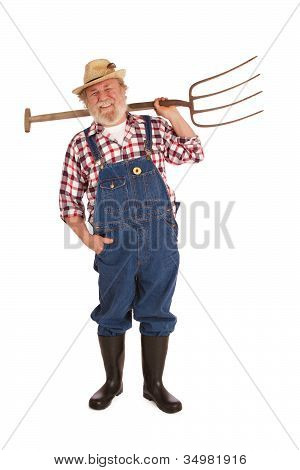 Happy Senior Farmer Lifting Hay Fork Up
