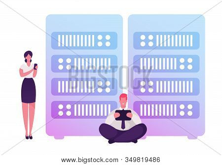 Businessman With Tablet Pc And Businesswoman With Smartphone Stand In Data Server Room Using Intrane