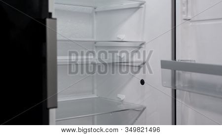 Opened Empty Refrigerator On Exposition Of Kitchen Appliances, Fridge Purchase