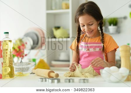 Portrait Of Young Girl Baking In The Kitchen
