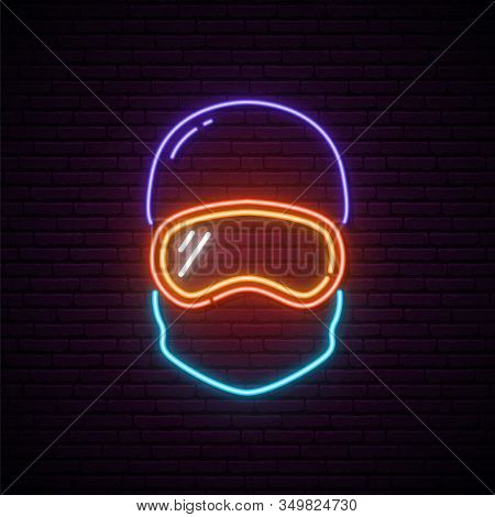 Snowboarder Neon Sign. Portrait Of Man With Blue Helmet And Orange Snowboard Mask. Vector Illustrati