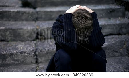 Lonely Boy Crying, Sitting On Old Cracked Steps, Frightened War Child, Homeless