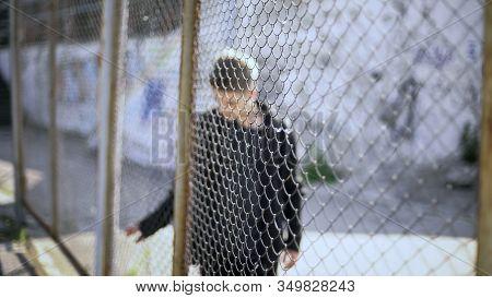 Teen Boy Behind Fence Confinement, Boarding School Restrictions, Broken Future