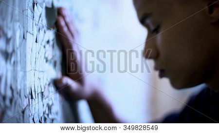 Afro-american Teen Touching Flaky Wall, Poverty And Life Difficulties, Sadness