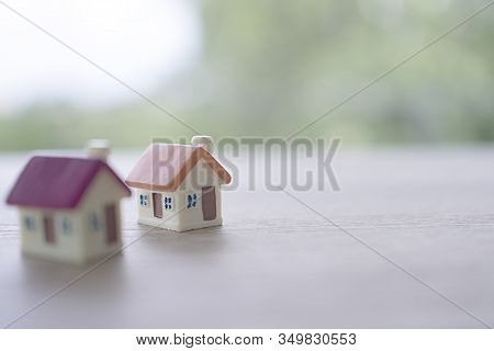 Small House On Background. Home For Sale And Home For Rent Concept.