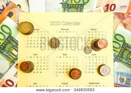 Stack Of Coins On Calendar, Closeup Shot, For Finance Background, Coin Calendar, Time Is Money, Mone