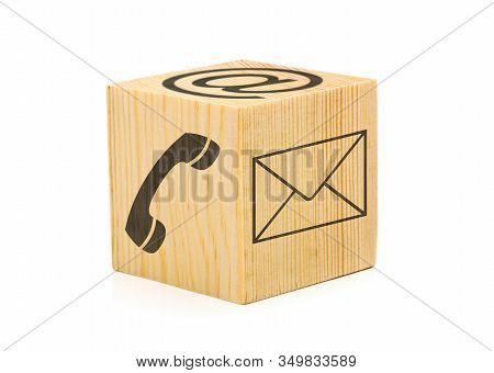 Contact Us Symbols With Phone, E-mail And Envelope Icons On Single Brown Wooden Cube On White Backgr