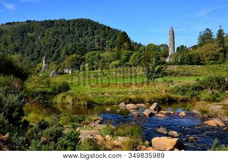 Landscape With Old Celtic Round Tower In Glendalough
