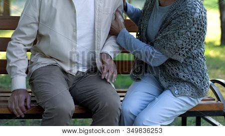 Female Supporting Old Sick Friend, Sitting In Hospital Park, Parkinson Disease