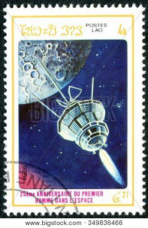 Laos - Circa 1986: A Stamp Printed In Laos, Dedicated To The 25th Anniversary Of First Man In Space,