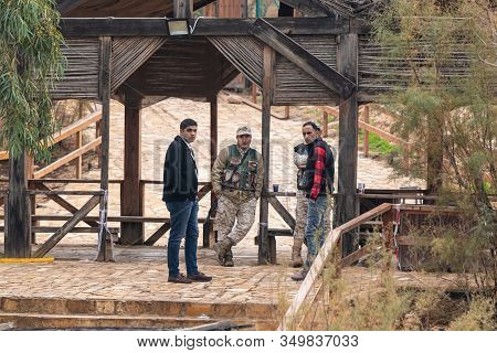 Jericho, Israel, January 18, 2020 : Jordanian Border Guards And Officials Look From The Jordanian Si