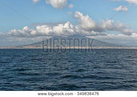 Vesuv In Cloudy Sky Photo From The Sea Boat