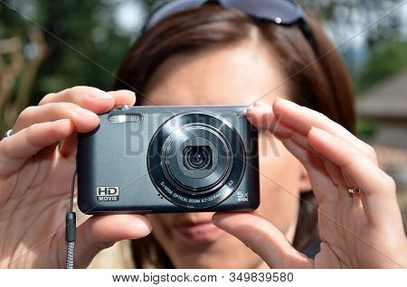 Young Lady Photographing With Compact Digital Camera Detail Photo