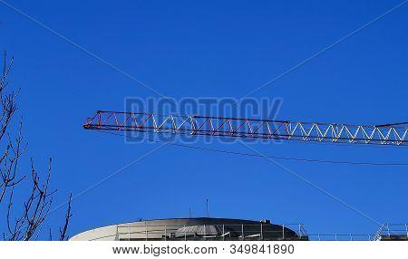 Crane On A Construction Site Against Blue Sky