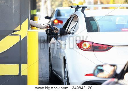 Convenient Payment From Car, Drive Thru System. Payment For Services Credit Card Using Pos Terminal.