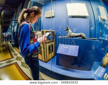Moscow, Russia - Jan 14, 2020: Schoolgirl Studies The Archaeological Finds Exposition Of The Egyptia