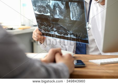 Health Screening, Doctor Is Looking At Mri Data. Man Brought To Doctor Tomographic Medical Image To