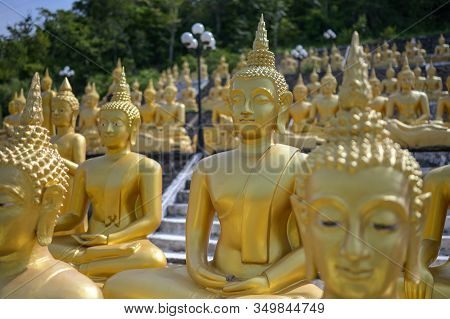 The Group Of Golden Buddha Statues Of Phu Salao Temple In The Pakse City, Champasak Province, Southe