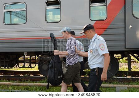 Moscow, Russia - June 17, 2019:transport Police Officers Disembarked A Passenger From The Train Viol