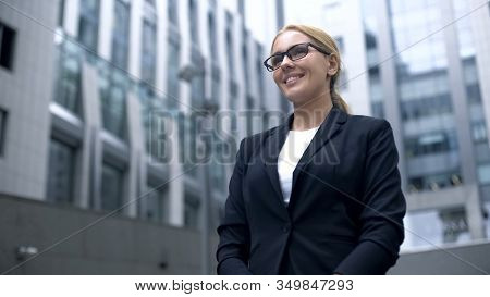 Friendly Woman In Suit Meets Foreign Business Partners, Interpreter Or Hostess