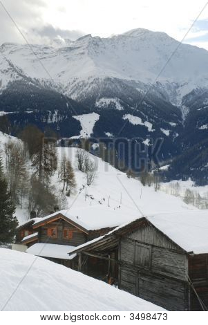Swiss Mountain Village Withchalets And Snow