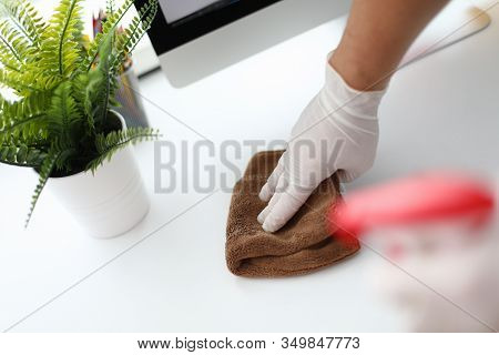Thorough Cleaning Workplace, Near Home Computer. Human Hand In White Silicone Glove Wipes Surface Ta