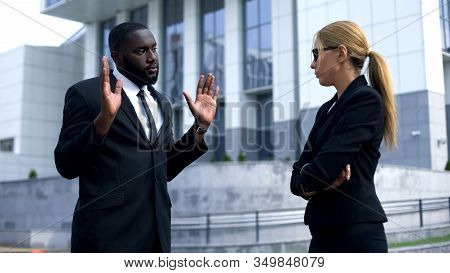Female Boss Offending Afro-american Employee, Man Trying To Justify His Doings