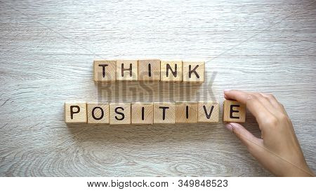 Think Positive, Woman Making Phrase Of Wooden Cubes, Motivation And Inspiration